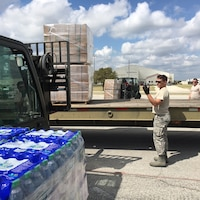 Second Lt. Alberto, 12th Training Squadron student, helps load relief supplies in preparation for air transport Sept. 22, 2017 at Joint Base San Antonio-Kelly Field.  The supplies were being staged at the Federal Emergency Management Agency's Incident Support Base at Kelly for transport to areas devastated by Hurricane Maria. (U.S. Air Force image/Dan Hawkins)
