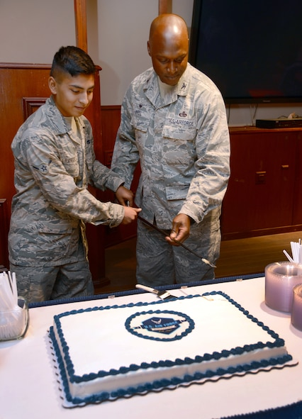 Airman Juan Rangel, with the 552nd Aircraft Maintenance Squadron, and 72nd Air Base Wing Commander Col. Kenyon Bell were the honorary cake-cutters at Tinker's celebration of the Air Force's 70th birthday Sept. 18 at the Tinker Club.