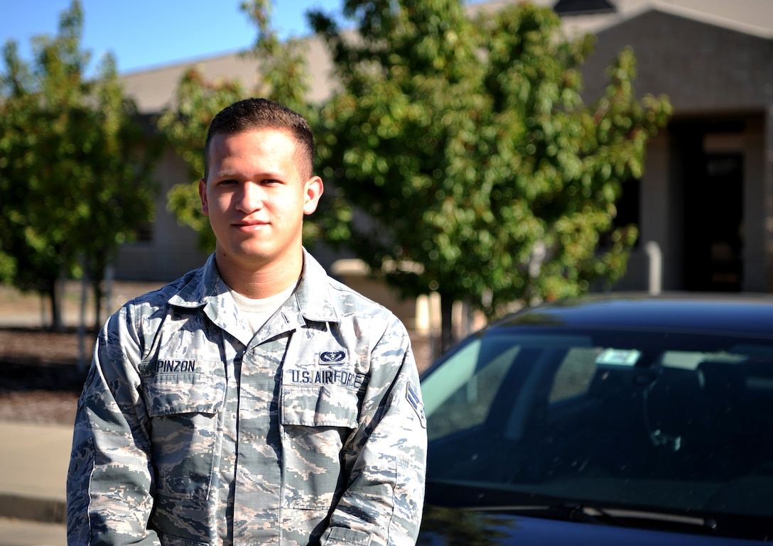 Airman 1st Class Santiago Pinzon,9th Civil Engineer Squadron heating, ventilation, and air conditioning technician poses for a photo