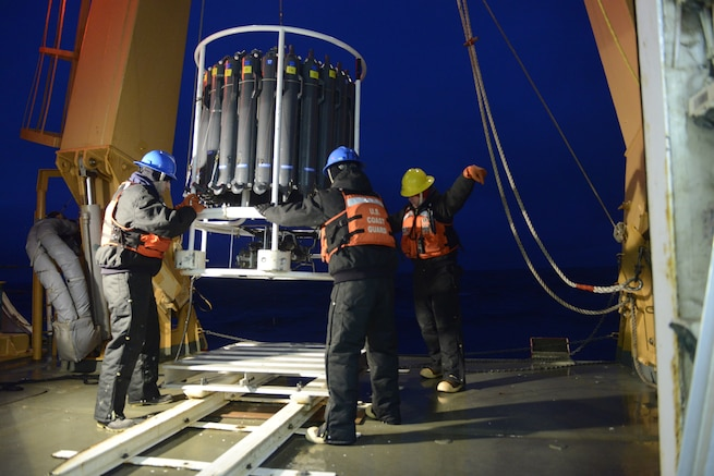 MSTC Winegar gives the signal to bring in the CTD rosette from over the side and set it on deck.