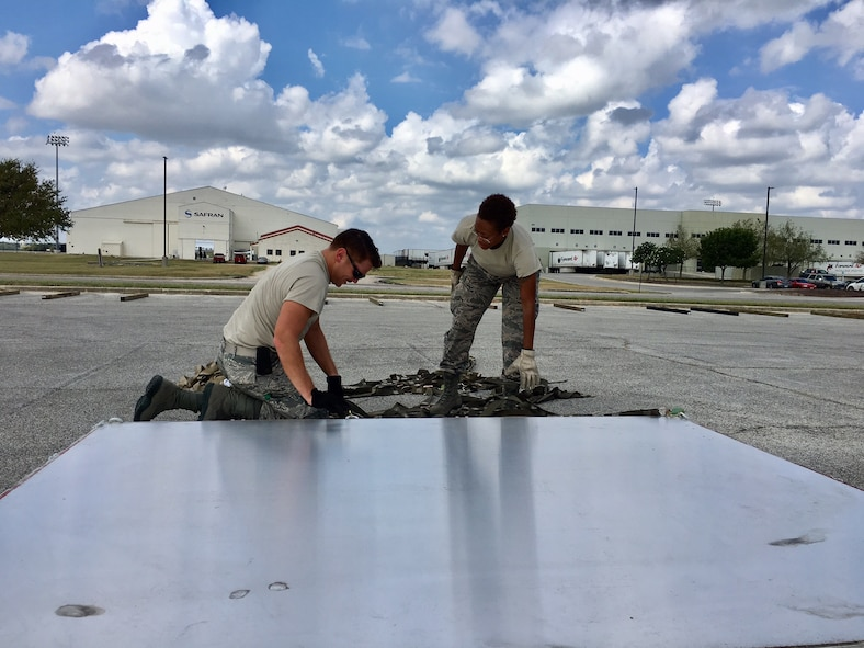 12th Training Squadron students help prepare a pallet for air transport Sept. 22, 2017 at Joint Base San Antonio-Kelly Field.  The supplies were being staged at the Federal Emergency Management Agency's Incident Support Base at Kelly for transport to areas devastated by Hurricane Maria (U.S. Air Force image/Dan Hawkins)