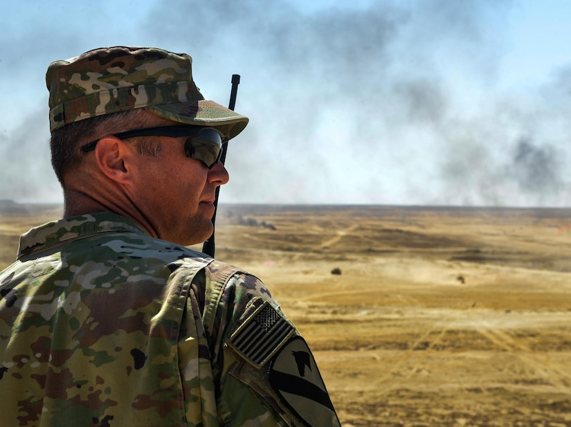 U.S. Army Lt. Col. William Wade, 2nd Battalion, 7th Cavalry Regiment, 3rd Armored Combat Team, 1st Cavalry Division battalion, watches the conclusion of a combined arms live fire exercise during Bright Star 2017, Sept. 20, 2017, at Mohamed Naguib Military Base, Egypt. Bright Star was last held in 2009 with more than 15 countries and 15,000 participants. (U.S. Air Force photo by Staff Sgt. Michael Battles)