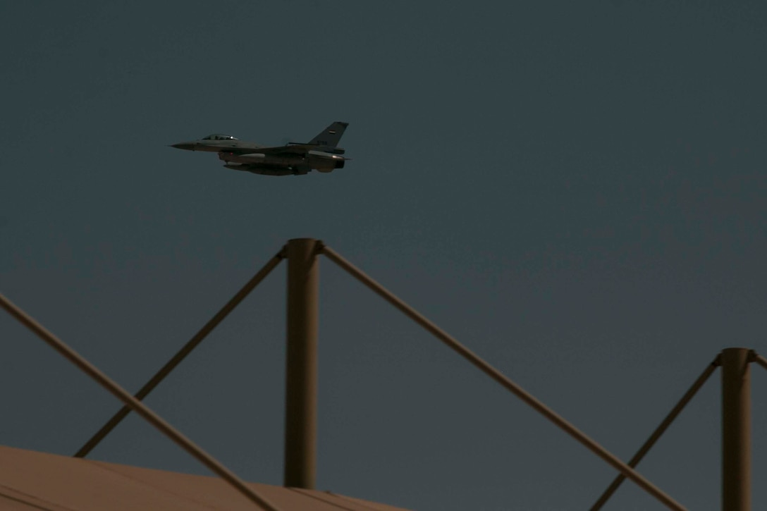 An Egyptian F-16 Fighting Falcon flies over the reviewing stand at the live-fire range after dropping flares at the start of the culminating joint combined live-fire exercise of Exercise Bright Star 2017 at Mohamed Naguib Military Base, Egypt, Sept. 20. Bright Star is a bilateral exercise between U.S. Central Command and the Arab Republic of Egypt during which about 200 U.S. personnel participated in a command-post exercise, a field training exercise and a senior leader seminar to promote and enhance regional security and cooperation. (U.S. Army photo by Staff Sgt. Leah R. Kilpatrick)