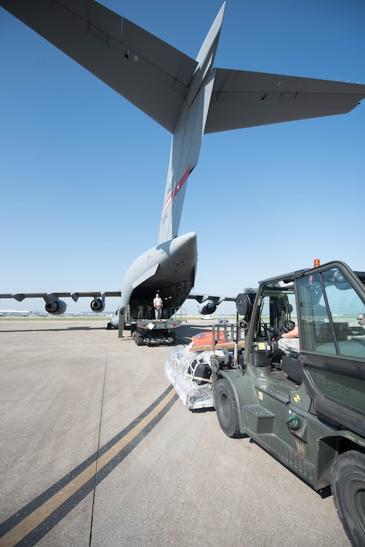 Airmen from the 123rd Airlift Wing load equipment onto a West Virginia Air National Guard C-17 at the Kentucky Air National Guard Base in Louisville, Ky., Sept 23, 2017, in support of Hurricane Maria recovery operations. Thirty-two members of the Kentucky Air National Guard's 123rd Contingency Response Group are deploying to San Juan, Puerto Rico, along with the equipment to establish an air cargo hub to process relief supplies.