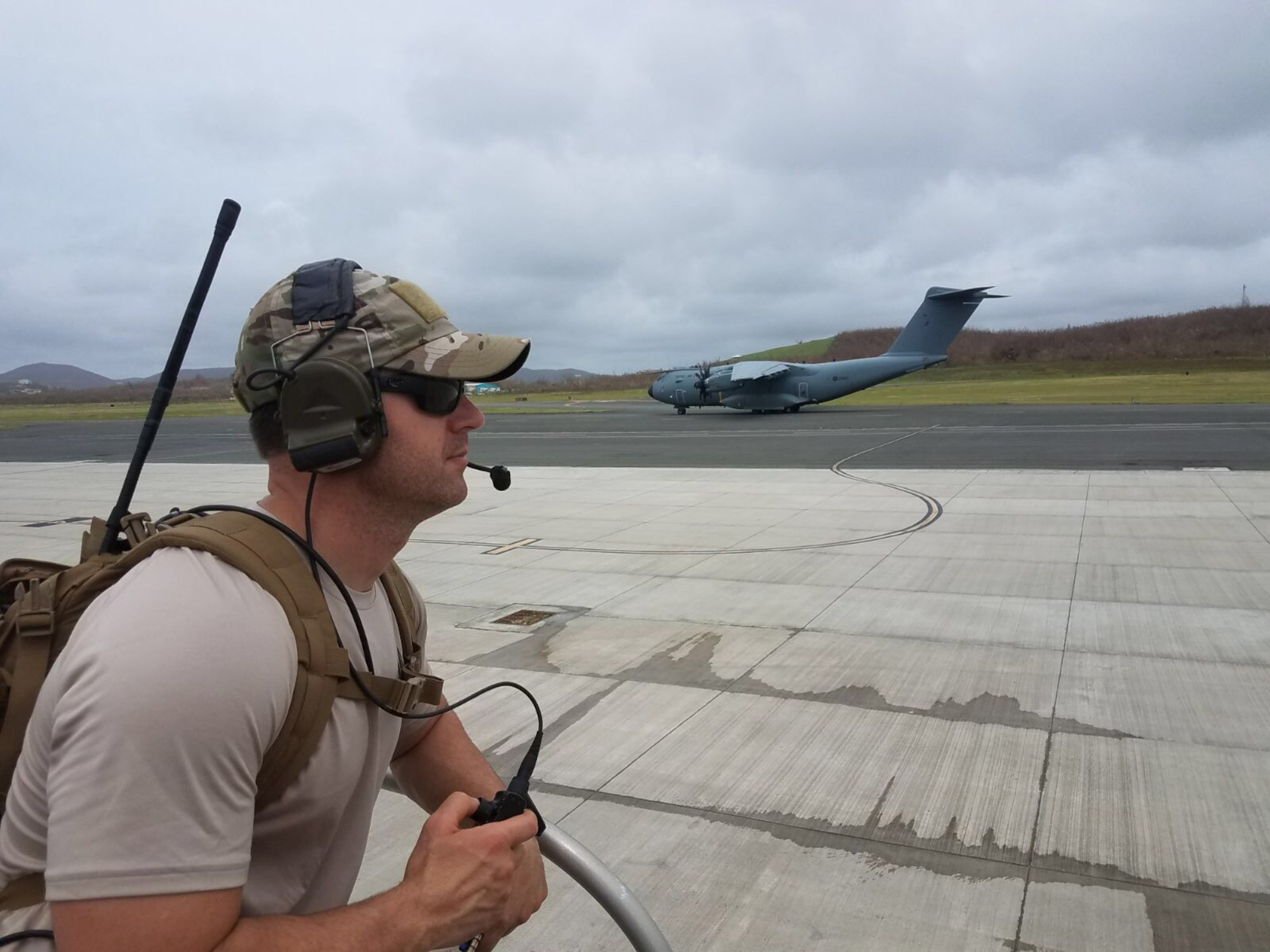Master Sgt. Harley Bobay, a combat controller in the Kentucky Air National Guard's 123rd Special Tactics Squadron, provides air traffic control to planes delivering relief supplies to Henry E. Rohlsen Airport on St. Croix, U.S. Virgin Islands, Sept. 22, 2017. Bobay is one of seven Airmen from the unit who deployed to the Caribbean to support recovery operations following Hurricane Maria.