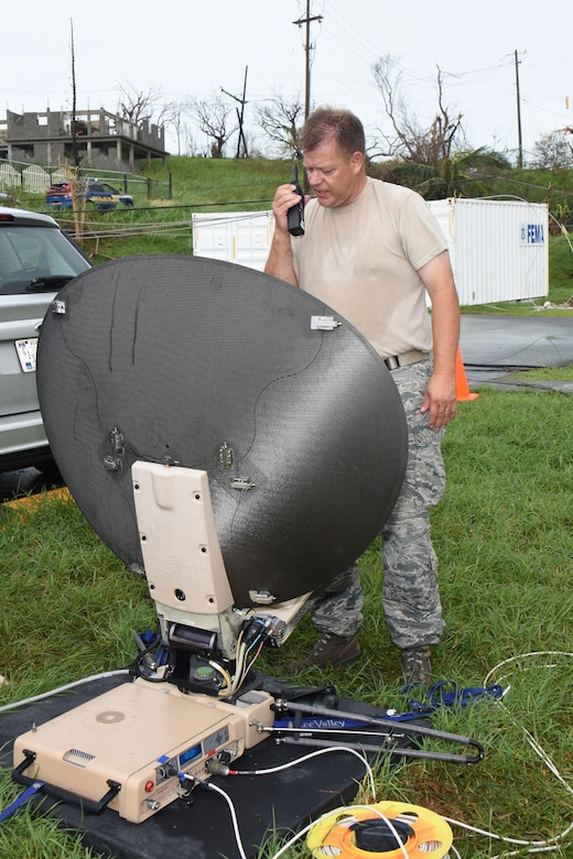 Air National Guard Chief Master Sgt. Don Johnnson, Joint Incident Site Communication Capability noncommissioned officer in charge with the 151st Air Refueling Wing Communications Flight in Salt Lake City, Utah, confirms configuration status of a SWE-DISH CCT120 satellite dish outside the Leonard B. Francis Armory in St. Thomas, U.S. Virgin Islands, Sept. 20, 2017. The Sept. 7 deployment of the Utah JISCC helped re-establish critical military and emergency civil service communications within areas of the U.S. Virgin Islands severely impacted by Hurricanes Irma and Maria. (U.S. Air National Guard photo by Master Sgt. Paul Gorman)