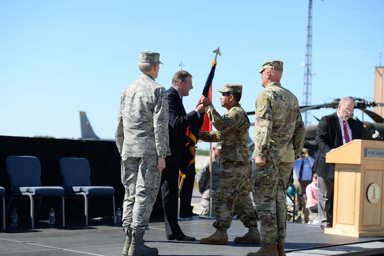 Gov. Christopher T. Sununu passes the colors to Brig. Gen. David J. Mikolaities during change of command ceremony at Pease Air National Guard Base, Sept. 23, 2017. Brig. Gen. David Mikolaities assumes duties as the Adjutant General, New Hampshire National Guard from Maj. Gen. William Reddel. (N.H. National Guard photo by Senior Airman Ashlyn J. Correia)