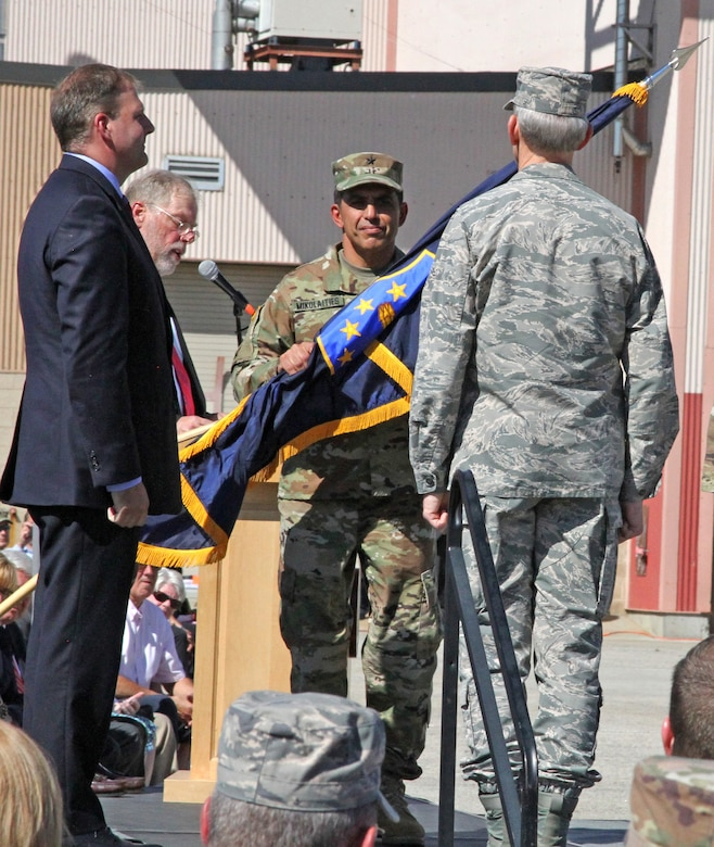"Brig. Gen. David Mikolaities assumes command as The Adjutant General for the State of New Hampshire and takes receipt of the state's National Guard colors during a ceremony at Pease Air National Guard Base ,N.H,  Sept. 23, 2017.  In attendance was Gov. Christopher T. Sununu and outgoing adjutant general, Maj. Gen. William, N. Reddel. The ceremony was attended by nearly 1,000 Soldiers and Airmen. ""To the Soldiers and Airmen of the New Hampshire National Guard, it's an honor to serve with you and for you,"" said Mikolaities. (NH National Guard photo by Sgt. Charles W. Johnston)"