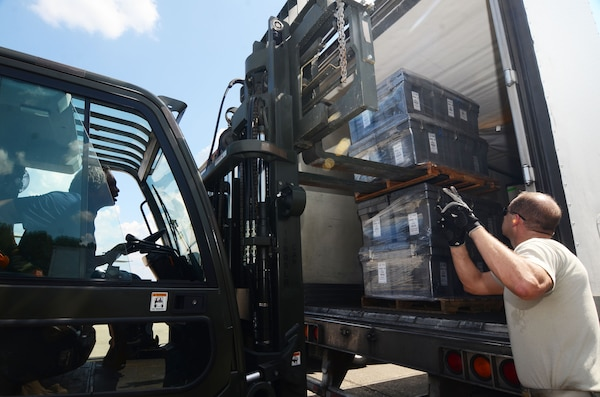 A forklift driver unload pallets of medical supplies from the back of a semi-truck at Dobbins Air Reserve Base, Ga. Sept. 21, 2017. This cargo included items needed to build a hospital from scratch – everything from the tents required to house the temporary structure to the medical equipment used to treat patients. (U.S. Air Force photo/Don Peek)