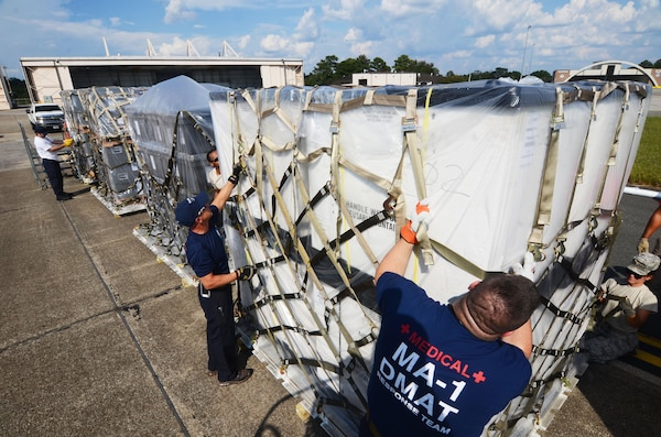Disaster Medical Assistance Team members secure a cargo net around a pallet of medical supplies on the flightline at Dobbins Air Reserve Base, Ga. Sept. 21, 2017. The DMAT is a federalized workforce of doctors, nurses, paramedics, emergency management technicians, safety, and others who provide medical care during natural disaster relief efforts. (U.S. Air Force photo/Don Peek)
