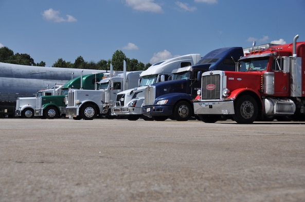 Semi-trucks line up on the flightline at Dobbins Air Reserve Base, Ga. Sept. 21, 2017 and wait to be offloaded. The trucks transported various supplies from all over the country to Dobbins where they were palletized and loaded onto C-17 Globemaster III aircraft and flown to provide hurricane relief. (U.S. Air Force photo/Tech. Sgt. Kelly Goonan)