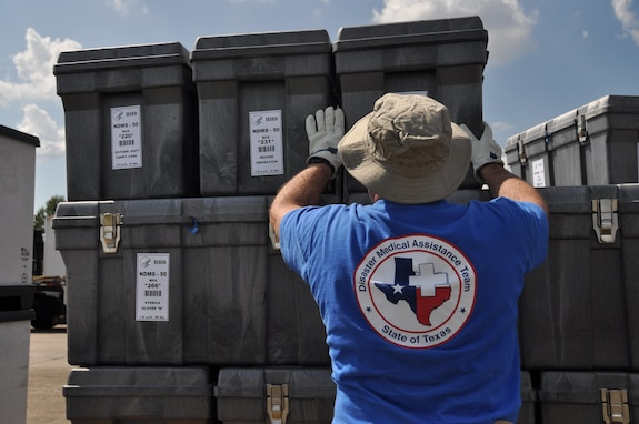 A Disaster Medical Assistance Team member arranges medical supplies on a pallet on the flightline at Dobbins Air Reserve Base, Ga. Sept. 21, 2017. The DMAT is a federalized workforce of doctors, nurses, paramedics, emergency management technicians, safety, and others who provide medical care during natural disaster relief efforts. (U.S. Air Force photo/Tech. Sgt. Kelly Goonan)