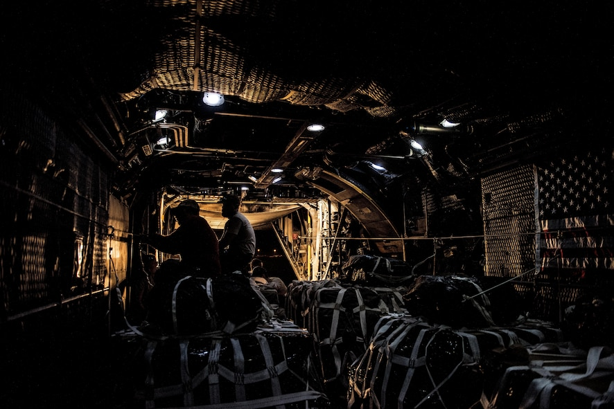 U.S. Army Staff Sgt. Jose Moreno (left), a parachute rigger assigned to the 294th Quartermaster Company, attaches static line rigging on an airdrop bundle in the rear of a C-130 aircraft at an undisclosed location in Southwest Asia, Sept. 10, 2017. Airdrop bundles are rigged within specific guidelines to ensure the cargo properly exits the aircraft, the parachute properly deploys and the bundle lands intact on its target. (U.S. Air Force photo by Tech. Sgt. Jonathan Hehnly)