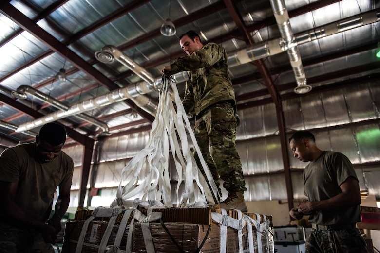 A team of U.S. Army parachute riggers rig a supply bundle in preparation for an airdrop mission at an undisclosed location in Southwest Asia, Sept. 6, 2017. Airdrop bundles are rigged within specific guidelines to ensure the cargo properly exits the aircraft, the parachute properly deploys and the bundle lands intact on its target. (U.S. Air Force photo by Tech. Sgt. Jonathan Hehnly)