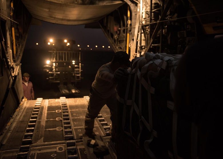 An U.S. Air Force loadmaster loads a C-130 aircraft with supply bundles in preparation for an airdrop mission at an undisclosed location in Southwest Asia, Sept. 10, 2017. Airdrop bundles are rigged within specific guidelines to ensure the cargo properly exits the aircraft, the parachute properly deploys and the bundle lands intact on its target. (U.S. Air Force photo by Tech. Sgt. Jonathan Hehnly)