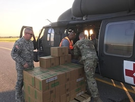 Members of the DLA Distribution Expeditionary team provided critical support to USNORTHCOM and FEMA by loading over 14,800 Commercial Meals and 11,760 liters of bottled water onto Texas National Guard and U.S. Border Patrol CH-47, UH-60, and UH-1 aircraft at Randolph Auxiliary Airfield in Seguin, Texas.
