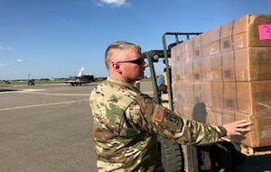DLA Distribution Expeditionary commander U.S. Army Maj. Jesse B. Holmes inspects a pallet of supplies before it is loaded onto Texas National Guard and U.S. Border Patrol CH-47, UH-60, and UH-1 aircraft at Randolph Auxiliary Airfield in Seguin, Texas.