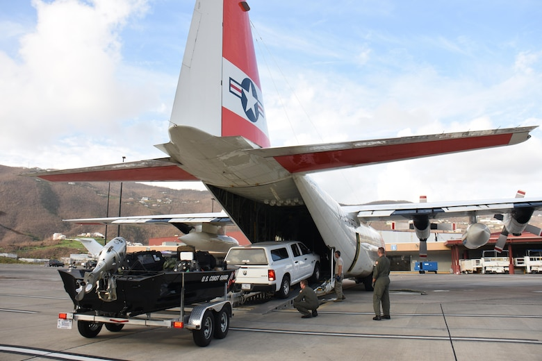 Air transportation specialists with the Air National Guard's 133rd Airlift Wing in Minneapolis, Minnesota assist with the download of cargo from a U.S. Coast Guard C-130H Hercules at Cyril E. King Airport in St. Thomas, U.S. Virgin Islands, Sept. 15, 2017. 133rd AW personnel joined Airmen assigned to the 146th Airlift Control Flight in Channel Islands, Florida and the 161st Air Refueling Wing in Phoenix, Arizona to manage air operations at the storm damaged airport in St. Thomas in the wake of Hurricane Irma. (U.S. Air National Guard photo by Master Sgt. Paul Gorman)