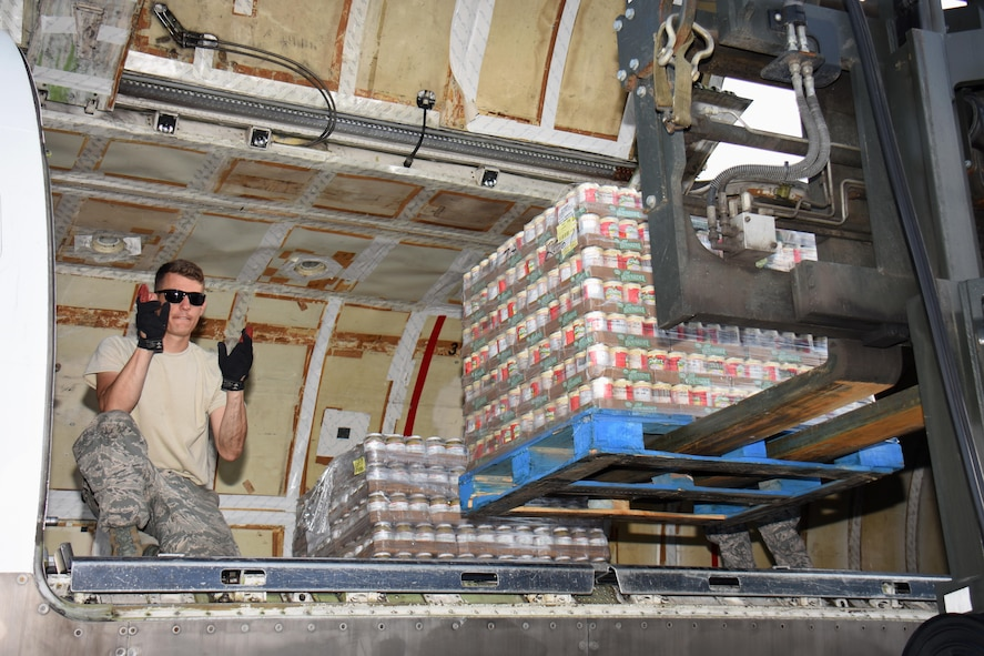 Air National Guard Master Sgt. Matt Hill, air transportation specialist with the 133rd Airlift Wing in Minneapolis, Minnesota, directs the offload of food and supplies pallets at Cyril E. King Airport in St. Thomas, U.S. Virgin Islands, Sept. 15, 2017. 133rd AW personnel joined Airmen assigned to the 146th Airlift Wing in Camarillo, California and the 161st Air Refueling Wing in Phoenix, Arizona to manage air operations at the storm damaged airport in St. Thomas in the wake of Hurricane Irma. (U.S. Air National Guard photo by Master Sgt. Paul Gorman)