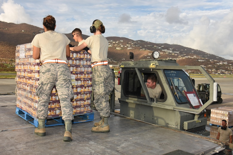 Air transportation specialists with the Air National Guard's 133rd Airlift Wing in Minneapolis, Minnesota utilize a Halvorsen loader to offload pallets of food and supplies at Cyril E. King Airport in St. Thomas, U.S. Virgin Islands, Sept. 15, 2017. 133rd AW personnel joined Airmen assigned to the 161st Air Refueling Wing in Phoenix, Arizona, and 146th Airlift Wing in Camarillo, California to manage air operations at the storm damaged airport in St. Thomas in the wake of Hurricane Irma. (U.S. Air National Guard photo by Master Sgt. Paul Gorman)