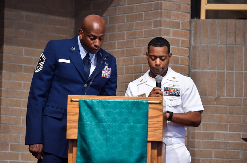Senior Master Sgt. Derrick Sherrod, left, 437th Maintenance Squadron first sergeant, and Culinary Specialist Senior Chief Corey Montgomery, right, read the names of fallen service members at Joint Base Charleston-Weapons Station, S.C., Sept. 21, 2017.