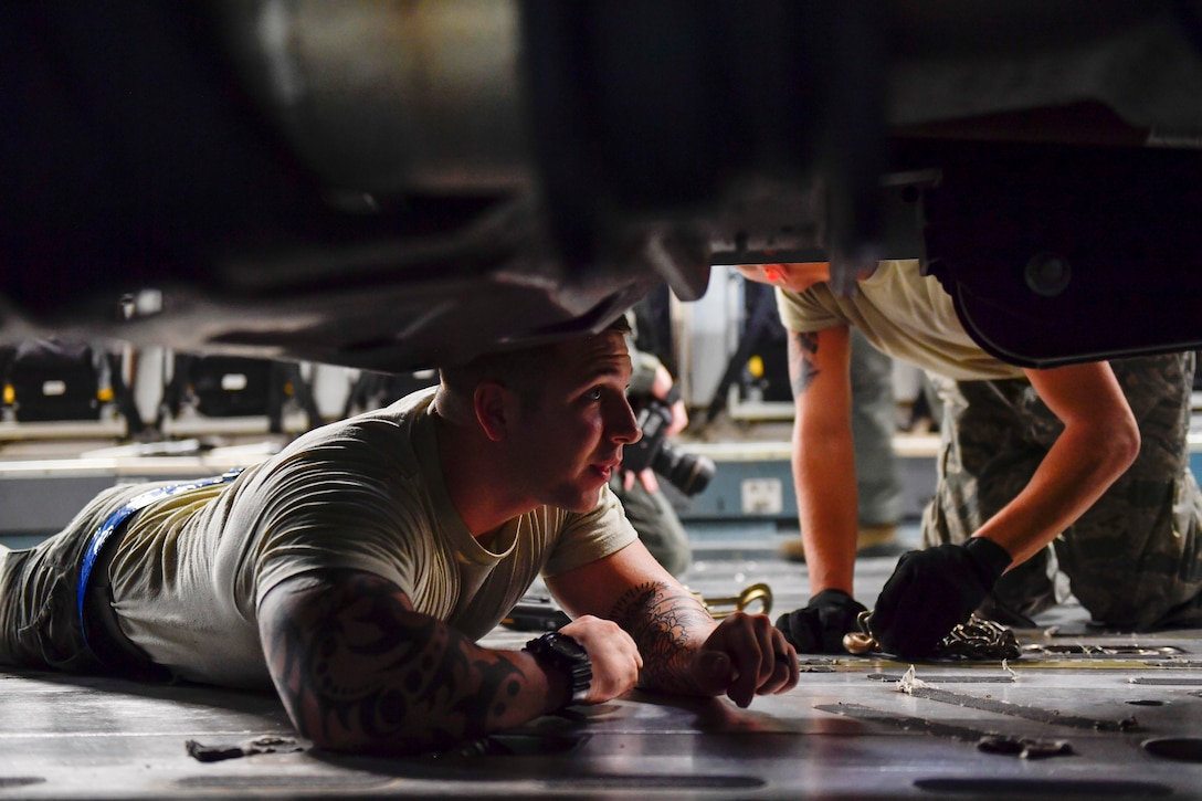A member of the 437th Aerial Port Squadron secures a truck to a C-17 Globemaster III at Joint Base Charleston, S.C., Sept. 23, 2017. The 14th Airlift Squadron, 437th Airlift Wing, flew a mobile air traffic control tower, food and water to St. Thomas, Virgin Islands in support of Hurricane Maria relief efforts.