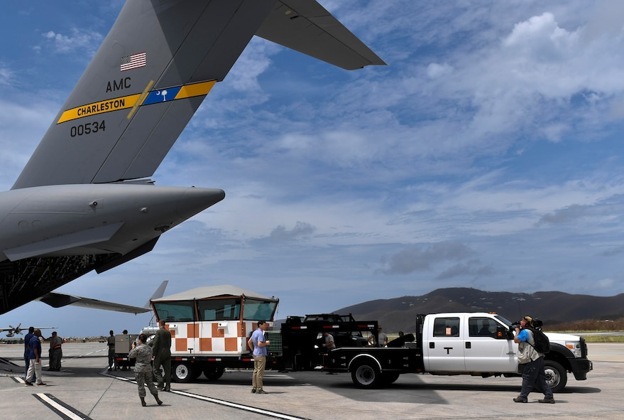 A mobile air traffic control tower is unloaded from a Joint Base Charleston C-17 Globemaster III in St. Thomas, Virgin Islands, Sept. 23, 2017. The 14th Airlift Squadron, 437th Airlift Wing, flew a mobile air traffic control tower, food and water to St. Thomas in support of Hurricane Maria relief efforts.