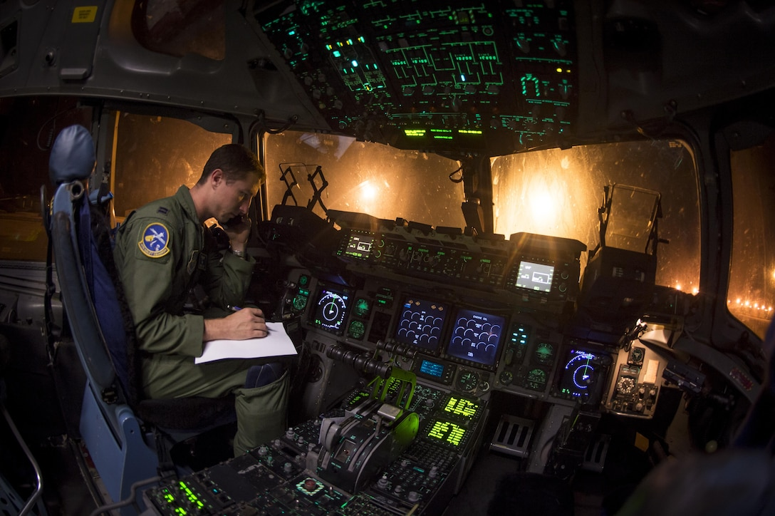 Capt. Woody Sukut, a C-17 pilot from the 14th Airlift Squadron, 437th Airlift Wing, verifies cargo details Sept. 23, 2017, at Joint Base Charleston, S.C. Airmen from JB Charleston provided relief efforts to those recently affected by Hurricanes Irma and Maria. The cargo included pallets of meals ready to eat, cases of water and a stand-up air traffic mobile control tower to support the relief operations at St. Thomas Cyril E. King Airport.