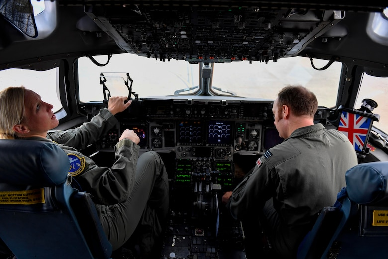 Maj. Kari Flemming, left, 14th Airlift Squadron pilot, and Flight Lt. Matt Jenkinson, right, 14th AS Royal air force exchange pilot, both from Joint Base Charleston, S.C., perform preflight checks at Kelly Field in San Antonio, Texas, Sept. 24, 2017. Members of the 14th AS delivered more than 129,000 pounds of food and water to St. Croix, Virgin Islands in support of relief efforts after Hurricane Maria. The mission to St. Croix marked the second mission the crew flew to the Virgin Islands for humanitarian aid in 48 hours.
