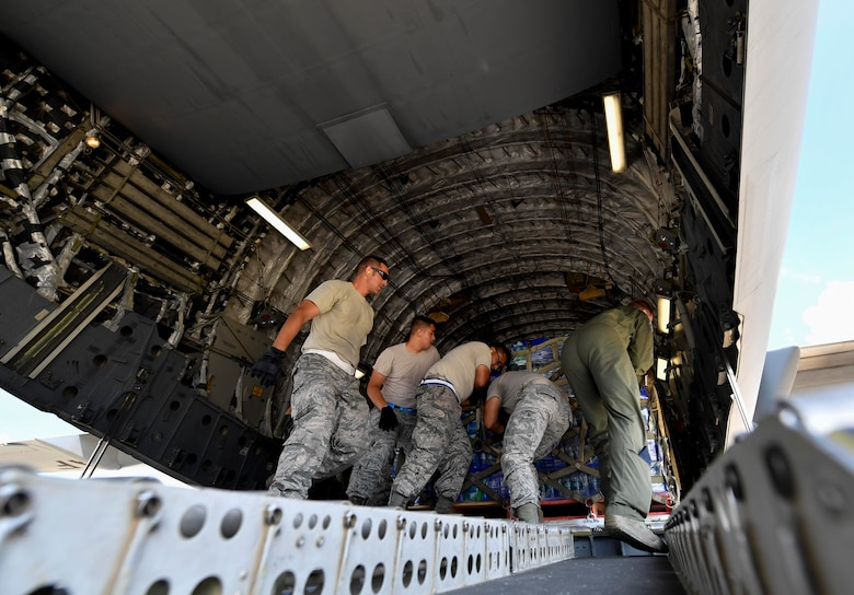 Airmen from the 502nd Logistics Readiness Squadron, from Joint Base San Antonio-Randolph, load cargo onto a C-17 Globemaster III at Kelly Field in San Antonio, Texas, Sept. 24, 2017. Members of the 14th Airlift Squadron, 437th Airlift Wing, delivered more than 129,000 pounds of food and water to St. Croix, Virgin Islands in support of relief efforts after Hurricane Maria. The mission to St. Croix marked the second mission the crew flew to the Virgin Islands for humanitarian aid in 48 hours.