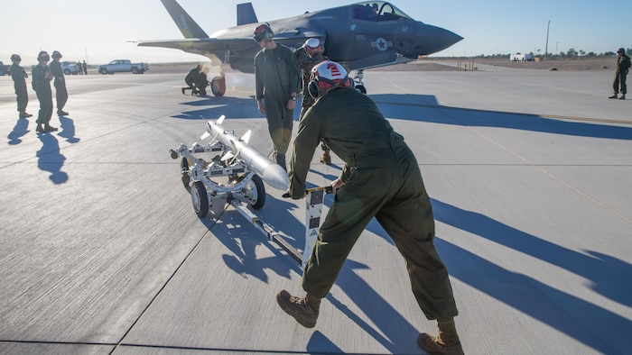 U.S. Marines with Marine Fighter Attack Squadron 121 Load Ordnance on a F-35B Lightning II