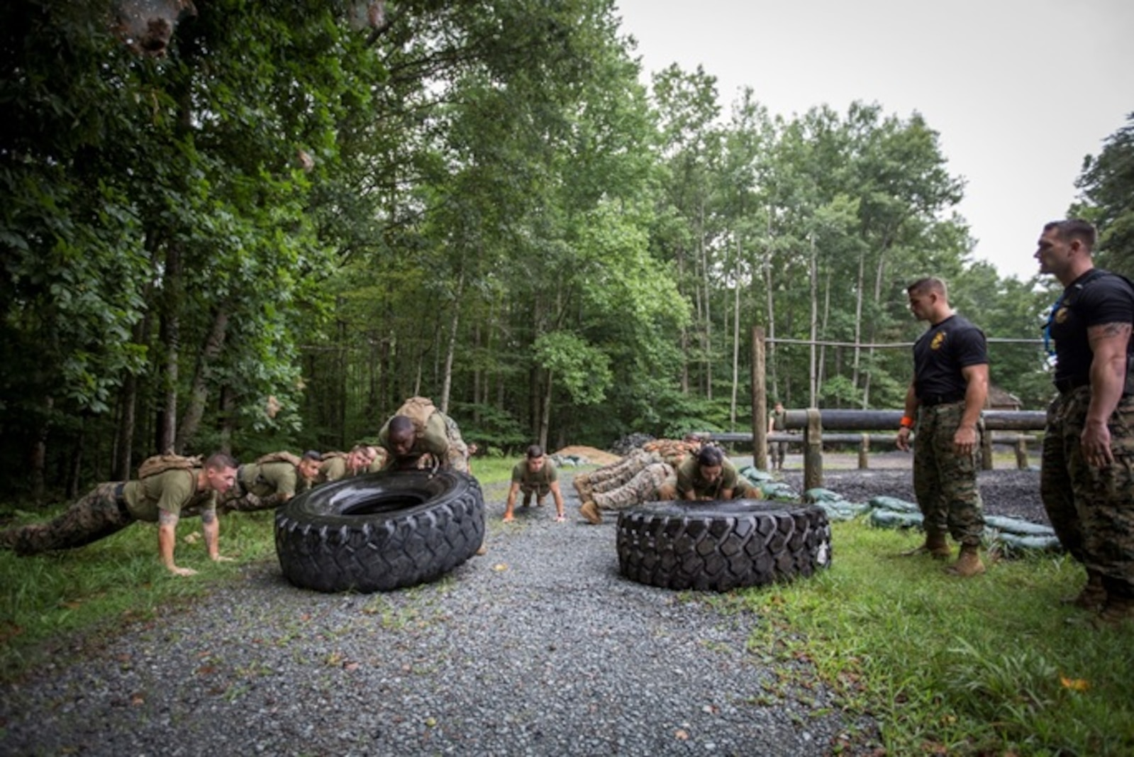 Marines conduct tire flips as part of a physical fitness competition with oversight from Force Fitness Instructor Trainers Sgt Cody Anderson and SSgt Britt Churchill during Force Fitness Instructor Course 4-17.