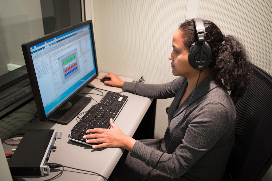 Nandini Iyer, a research audiologist in the 711th Human Performance Wing, studies data in one of her laboratories.