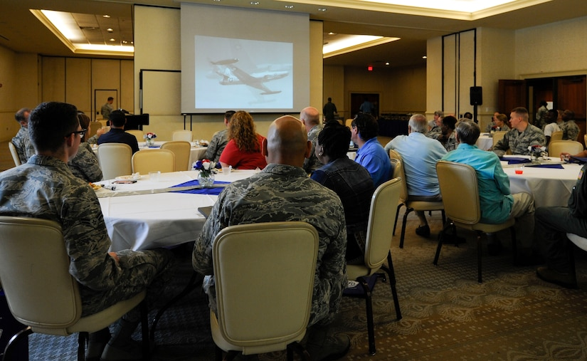 Members of Joint Base Charleston watch a video honoring the U.S. Air Force's 70th Anniversary at the Charleston Club, Sept. 22, 2017.
