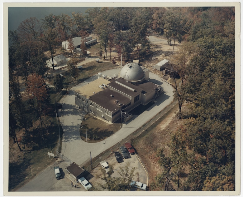 Aerial view of SM-1 nuclear reactor and plant circa the 1960s. SM-1 was the first nuclear power plant to successfully provide power to the commercial grid when it came online in April 1957. While SM-1's reactor was initially deactivated in 1973, the U.S. Army Corps of Engineers is in the process of planning for the reactor's decommissioning and dismantlement of the facility.