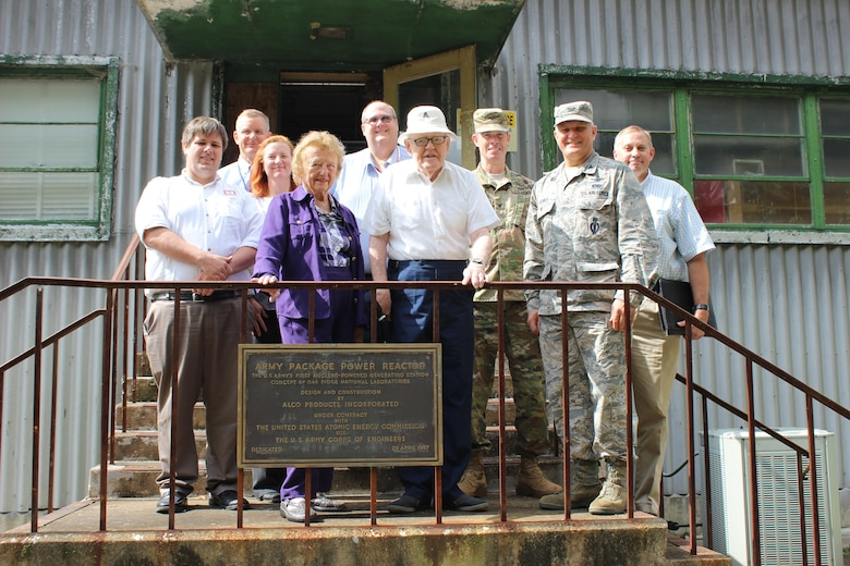 Retired Lt. Gen. Ernest Graves and his wife, Nancy Graves, stand behind the plaque from the April 29, 1957 dedication of SM-1 nuclear reactor and power plant.  During their visit on Tuesday September 19, 2017 with Department of Defense officials, Mrs. Graves recalled the last time she stood at this plaque with her husband more than sixty years prior.  Tour attendees included,  from left to right Chris Gardner, U.S. Army Corps of Engineers, Baltimore District; John Lonnquest, USACE, Headquarters Office of History; Brenda Barber, USACE, Baltimore District; Brian Hearty, USACE, Headquarters, Deactivated Nuclear Power Plant Program; Col. Allan Webster, USACE, Headquarters Military and International Operations; Col. Mark Bowen, Defense Threat Reduction Agency, Defense Nuclear Weapons School; and Matt Thompson, DTRA, Defense Nuclear Weapons School.
