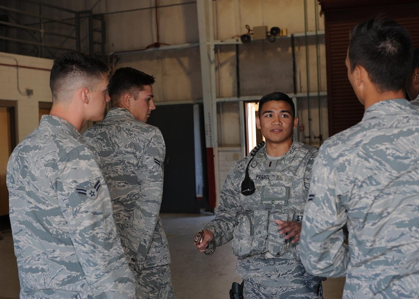 U.S. Air Force 2nd Lt. Robert Parati, 355th Security Forces Squadron flight commander, discusses the importance of technique when handcuffing at Davis-Monthan Air Force Base, Ariz., June 12, 2017. If the offender isn't properly detained, it can endanger the safety of the arresting officer. (U.S. Air Force photo by Senior Airman Ashley N. Steffen)