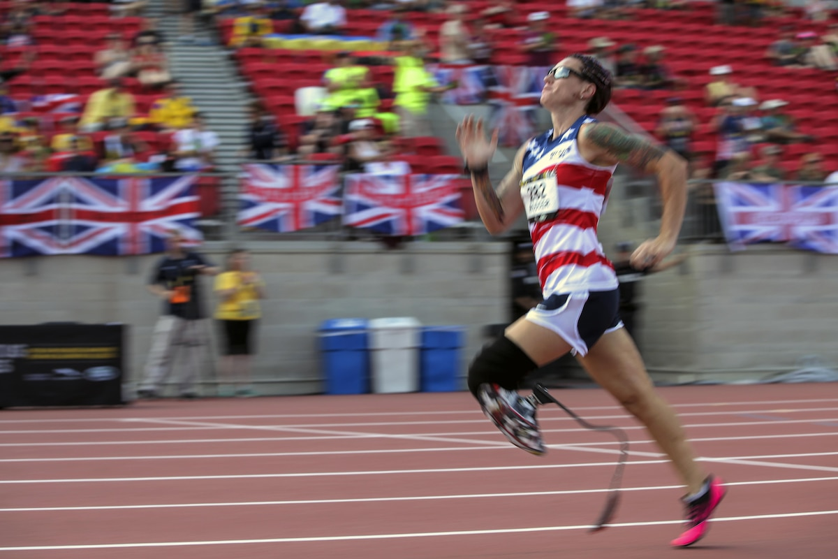 A retired Marine competes in a race during an international event.