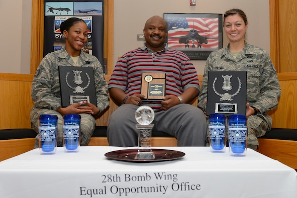 (From left to right) Tech. Sgt. Janay Stokes, Donald Bell, and Staff Sgt. Ashlei Philson, Equal Opportunity advisors assigned to the 28th Bomb Wing, hold four of the offices Col. L. Joseph Brown awards at Ellsworth Air Force Base, S.D., Sept. 22, 2017.  The team was presented their most recent award Sept. 14, and is the fourth consecutive, and fifth overall, Air Force or major command level award they have received. (U.S. Air Force photo by Airman Nicolas Z. Erwin)