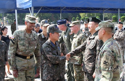 USAG YONGSAN, South Korea -- Republic of Korea Chairman of the Joint Chiefs of Staff Gen. Jeong, Kyeong Doo and Gen. Vincent K. Brooks, Combined Forces Command, United States Forces Command and United Nations Command greet senior leaders after a ceremony welcoming the new ROK CJCS at United States Army Garrison Yongsan, Sept. 26. (U.S. Army photo by Staff Sgt. Steven Schneider)