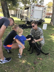 On September 22, 2017 as part of Better Half Day, Military Working Dog handlers and their dogs provided demonstrations on:  obedience, explosives detection, tracking, and attack capabilities. They also brought along older Military Working Dogs to socialize and interact with the spouses.