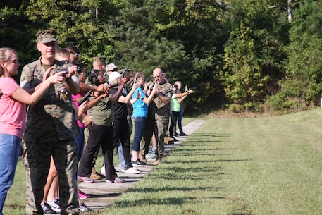 On September 22, 2017 Marine Corps Engineer School hosted a Better Half Day; the first event was a pistol range. While under the supervision of their Marine, acting as a Position Safety Officer; spouses conduct dry firing to familiarize themselves with the M9 pistol and course of fire.