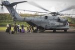 U.S. citizens board a U.S. Marine CH-53E Super Stallion helicopter with Joint Task Force - Leeward Islands at Douglas-Charles Airport in Dominica, Sept. 24, 2017.