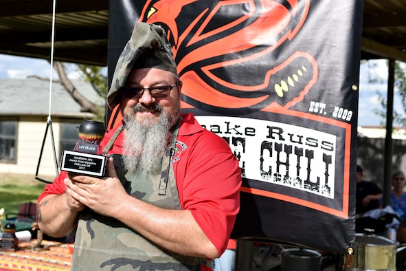Russell Dunlap, 312th Training Squadron supply technician, holds the Goodfellow Air Force Base Armed Forces Squadron Chili Cook-Off trophy during the Ruckus at the Rec Camp at the Goodfellow Air Force Base Recreation Camp, San Angelo, Texas, Sept. 23, 2017. The Ruckus is a combination of the 44th Annual Armed Forces Chili-Off, the 19th Annual Car and Bike show and a BBQ cook-off. (U.S. Air Force photo by Airman 1st Class Randall Moose/Released)