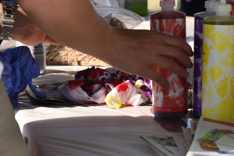 An Airman chooses colors for their tie-dye shirt during the event to die for at the marching pad on Goodfellow Air Force Base, Texas, Sept. 22, 2017. While the Airmen were meeting and greeting they also had the chance to learn from the noncommissioned officers about their personal experiences and about their special duties. (U.S. Air Force photo by Airman Zachary Chapman/Released)
