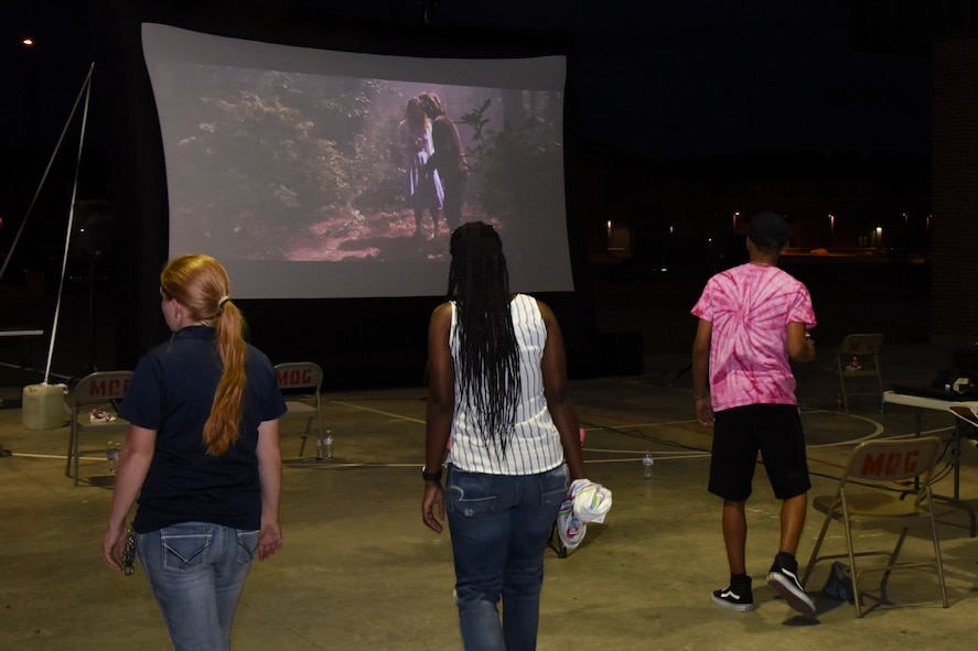 The event to dye for concludes with a showing of Guardians of the Galaxy 2 projected onto a blow up screen at the marching pad on Goodfellow Air Force Base, Texas, Sept. 22, 2017. The showing was an open air theater allowing individuals to bring blankets and their own chairs to watch on. (U.S. Air Force photo by Airman Zachary Chapman/Released)