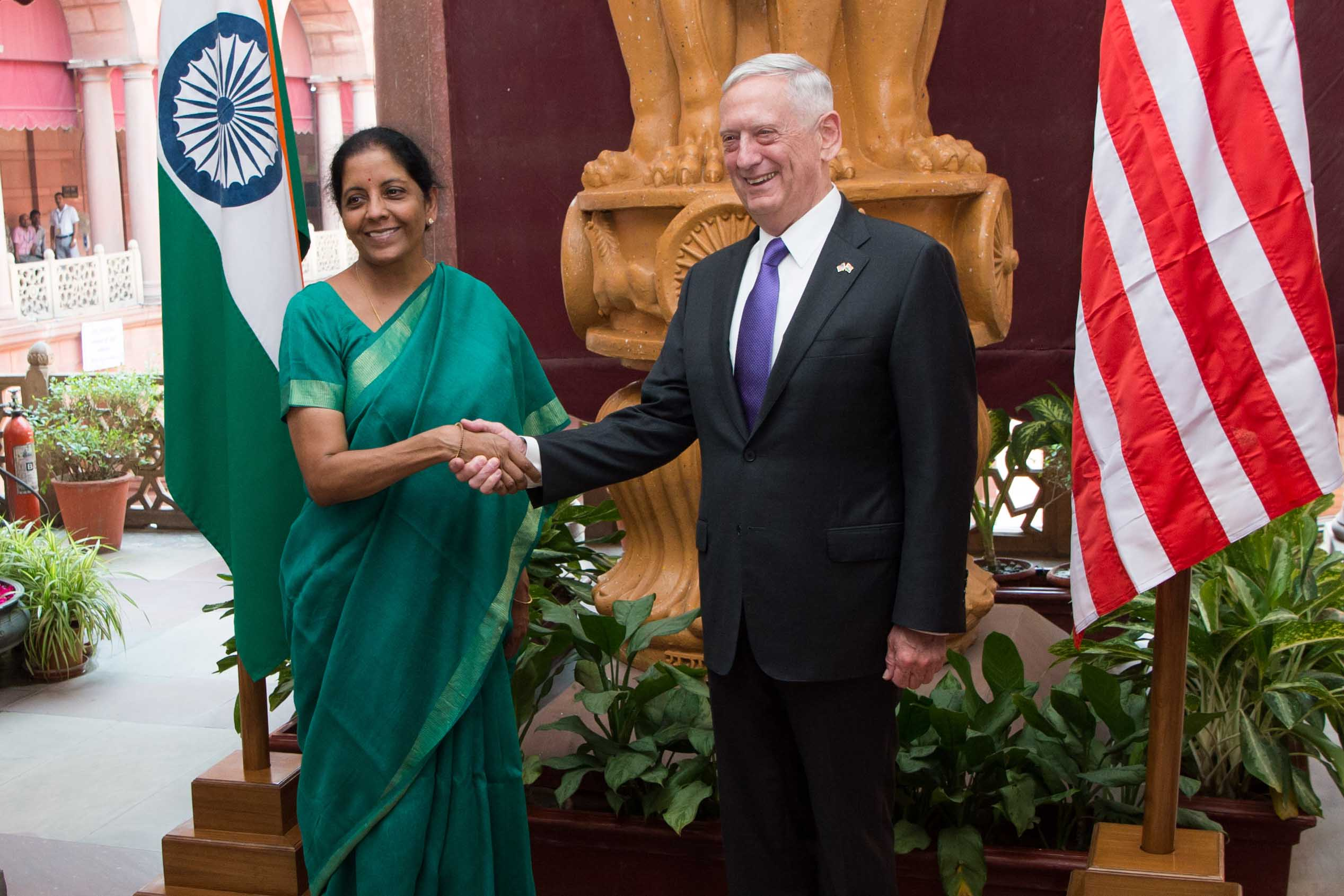 Defense Secretary Jim Mattis shakes hands with Indian defense leader.
