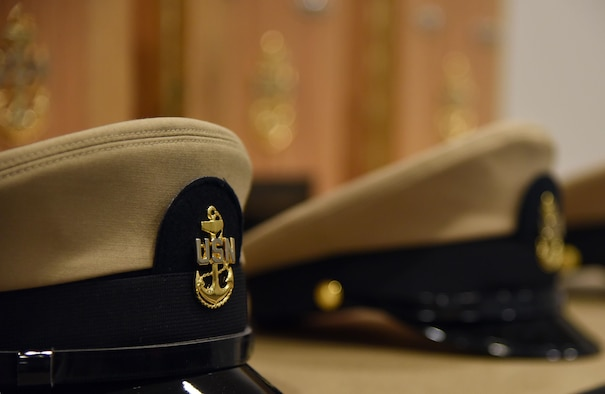 A U.S. Navy hat is on display during a Center for Naval Aviation Technical Training Unit Keesler Chief Petty Officer Pinning Ceremony at the Roberts Consolidated Aircraft Maintenance Facility Sept. 15, 2017, on Keesler Air Force Base, Mississippi. The six-week long Navy Chief Petty Officer Courses held at Keesler and the Naval Construction Battalion Center in Gulfport, Mississippi included four Air Force members, which is the first time Keesler Air Force members have gone through this process. The course is meant to enhance leadership skills and to strengthen the Navy-Air Force enlisted leadership relationship on Keesler. (U.S. Air Force photo by Kemberly Groue)