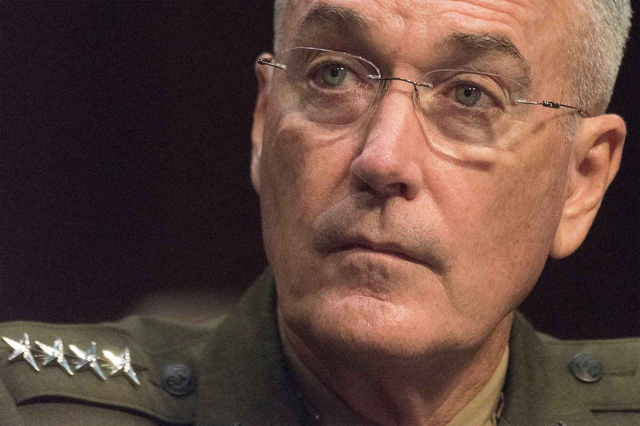 Marine Corps Gen. Joe Dunford, chairman of the Joint Chiefs of Staff, listens to a question during a Senate Armed Services Committee reconfirmation hearing