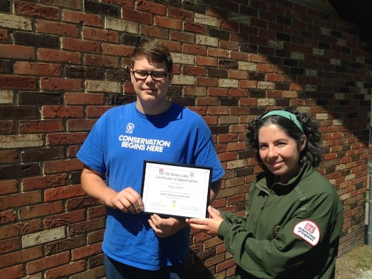 Brady Shrader was recognized by the staff of R.D. Bailey for his contributions as an Student Conservation Association (SCA) intern during the summer of 2017. Ranger Katy Smith presents Brady with a Certificate of Appreciation